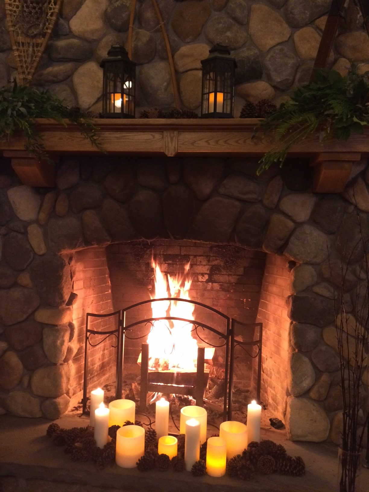 fireplace with candles in front