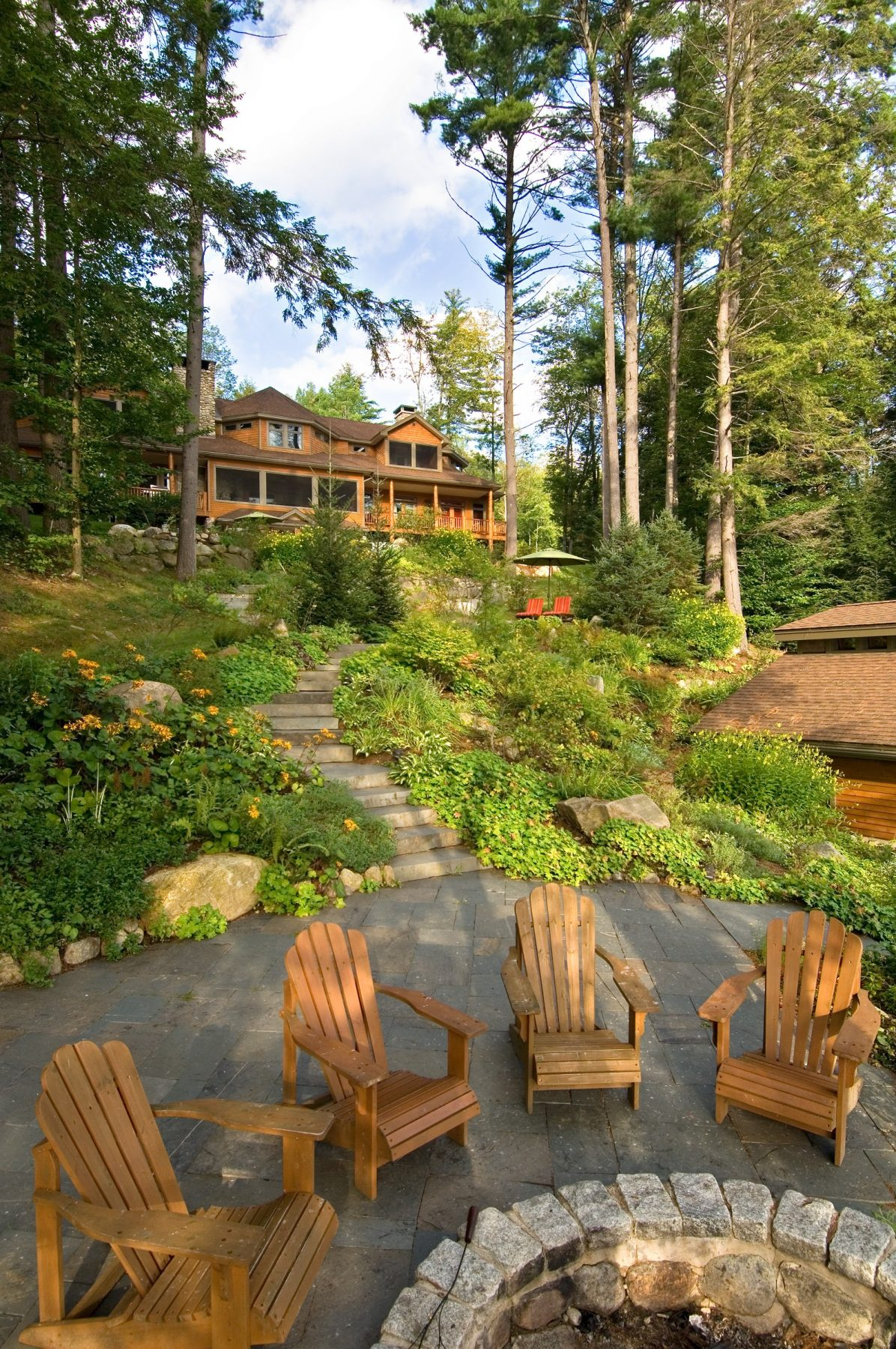 Walkway to fire pit with Adirondack Chairs