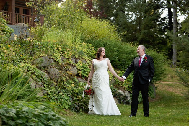 Bride and Groom holding hands in the garden