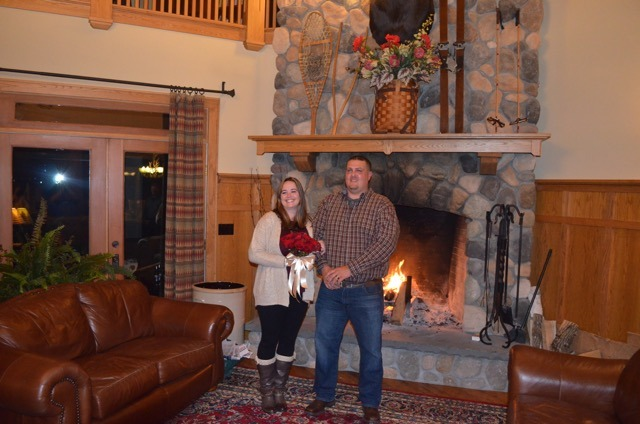 Bride and Groom pose in front of fire place
