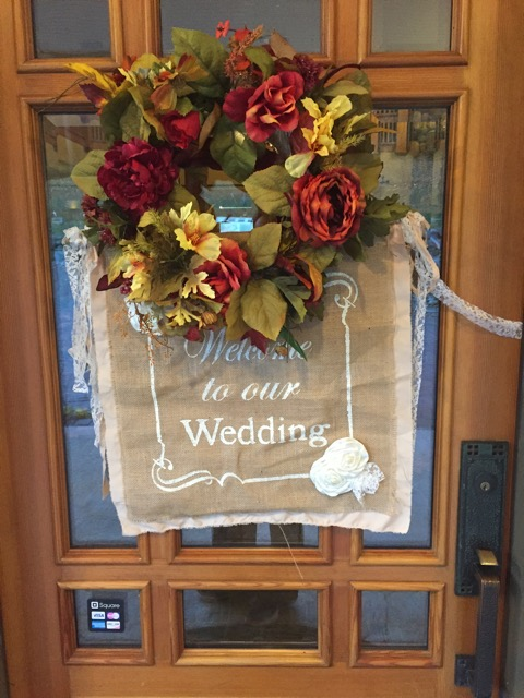 Rustic wedding sign on front door