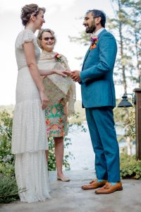 a couple getting married with the officiant