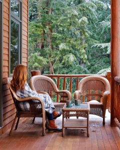 Woman enjoying coffee on the porch