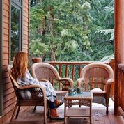 woman on porch in winter drinking hot choc